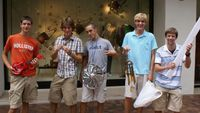 Posing with some of their purchases . . . Anthony actually found his new necklace in the garbage.