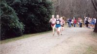 Oakton\'s Carlstrom and Jefferson Forest\'s Shannon Saunders rounding the lake