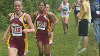 At the 1K mark, Warwick\'s Megan Lavoie leads with teammate Jessica Giffon on her shoulder.