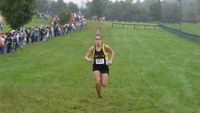 A determined Natalie Sherbak brings home a sixth place medal with her time of 20:31.39.