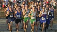 Through the first 1500 meters, a pack of close to twenty runners finds itself bunched up together. Leading the front line of pack is Midlothian\'s Billy Berlin (504), Atlee\'s Andrew Tucker (26), Maggie Walker\'s Andrew Stegmaier (604), Maggie Walker\'s D